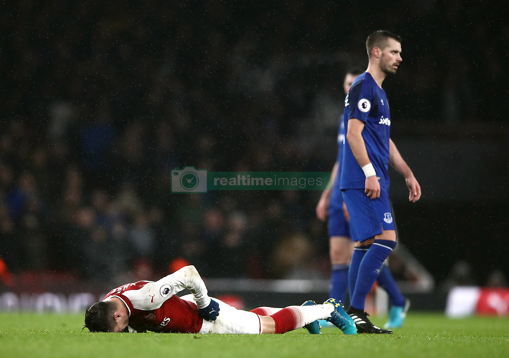Arsenal's Granit Xhaka lays on the ground injured during the Premier League match between Arsenal and Everton at Emirates Stadium