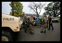 24 August 2006 - New Orleans - Louisiana. Lower 9th ward. Military police and NOPD officers apprehend and hold two suspects for looting abandoned houses. The witness who had reported the men taking items from houses could no longer be located and the men were released without charge.