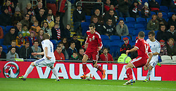 CARDIFF, WALES - Saturday, November 16, 2013: Wales' Gareth Bale in action against Finland during the International Friendly match at the Cardiff City Stadium. (Pic by David Rawcliffe/Propaganda)