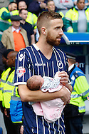 Mark Beevers of Millwall with baby after the Sky Bet Championship match at The Den, London<br /> Picture by David Horn/Focus Images Ltd +44 7545 970036<br /> 03/05/2014