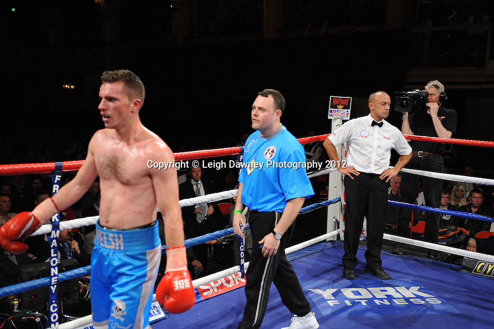 Martin Walsh (blue shorts) is disqualified and walks away after arguing with the referee who awards Rick Godding claimant of the Welterweight contest at The Winter Gardens, Blackpool on the 31st March 2012. Frank Maloney and Steve Wood VIP Promotions. © Leigh Dawney Photography 2012.