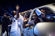 An impromptu street party after the Missouri State Highway Patrol take over the security in Ferguson. The involvement in the shooting and the sometimes heavy handed confrontations with protesters left the Ferguson Police Department with a lot of critic and distrust. Protesters and demonstrators in the streets of Ferguson, reacting to the death of Michael Brown (18). Michael Brown was fatally shot by police officer Darren Wilson.