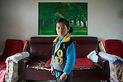 Liu Xu, age 9, whose parents have moved to Xian to be migrant workers, poses for a photograph at home in Chunhua county in  Shanxi province, China, on Monday, April 14, 2008. 58 million children, equal to the population of Italy, are left behind in China's villages as parents move to thriving cities for better-paying jobs.