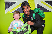 Forest Green Rovers Reece Brown(10) presents a signed shirt to the Horsley family during the EFL Sky Bet League 2 match between Forest Green Rovers and Milton Keynes Dons at the New Lawn, Forest Green, United Kingdom on 30 March 2019.