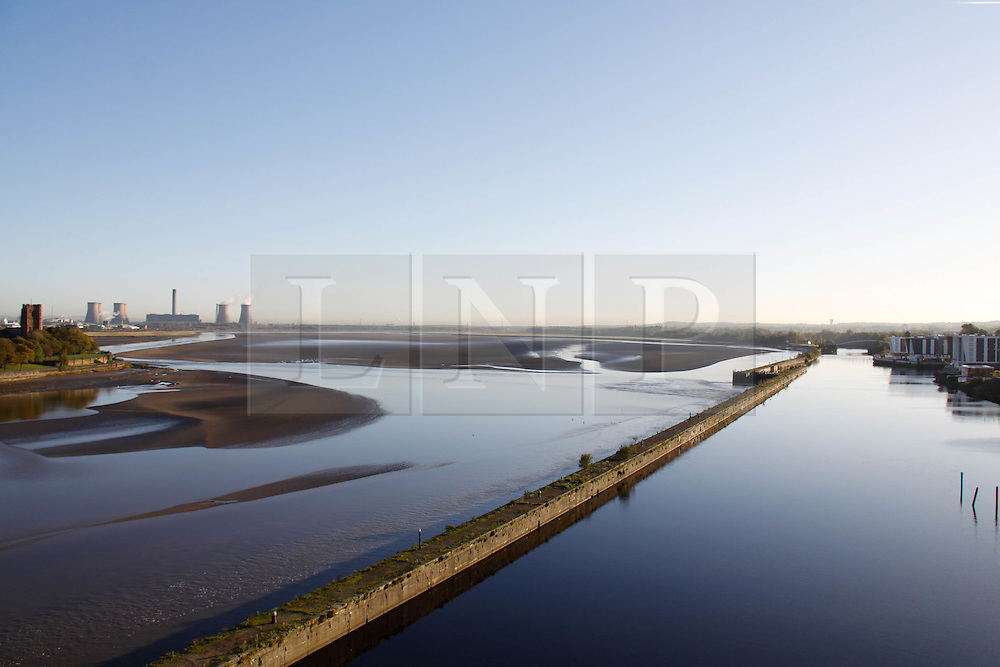 """Licensed to London News Pictures. 20.10.2010 The view where the new bridge will be built. Runcorn Widnes Bridge is expected to be redeveloped if the Chancellor gives the go-ahead in the Spending Review today. The Bridge will become a toll bridge along with its yet to be built sister bridge, 'The Mersey Gateway' if the project is given the green light in the  Government's Spending Review.  Mersey Gateway bosses have said they are 'strongly encouraged' by comments from Chancellor George Osborne MP that Mersey Gateway was an """"incredibly important project that I am really keen to see go ahead""""."""
