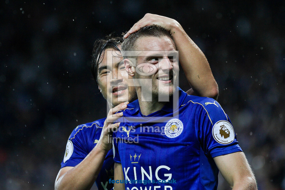 Shinji Okazaki of Leicester City (left)  celebrates with goalscorerJamie Vardy of Leicester City (right) during the Premier League match at the King Power Stadium, Leicester<br /> Picture by Andy Kearns/Focus Images Ltd 0781 864 4264<br /> 27/08/2016