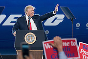 U.S. President Donald Trump waves before addressing employees at the debut of the new Boeing 787-10 Dreamliner aircraft at the Boeing factory February 17, 2016 in North Charleston, SC. The visit comes two days after workers at the South Carolina plant voted to reject union representation in a state where Trump won handily.