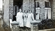woman friends in front of house with thumbs up hand in the window  England