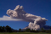 "Mount Merapi unleashes a 6-kilometer ""awan panas"" eruption in the shape of a giant seated poodle at 1:30 a.m. on 11 June 2006. The hind legs of poodle mark an eruption streaming down Kali Gendol, aiming towards Kali Adem, the site of two deaths on 14 June. Many observers wonder why the alert status of the volcano was lowered on 13 June following recent large eruptions and in the face of continued threats that 6,000,000 cubic meters of fresh lava dome appeared ready to tumble from the summit."