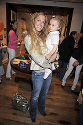 LAURA COMFORT and her daughter ISABELLA at 'Paint Your Polo Celebration' a children's party in aid of the charity Clic Sargent held at Ralph Lauren, 139/141 Fulham Road, London on 28th April 2009.