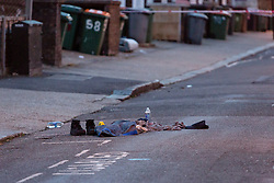 © Licensed to London News Pictures. 25/03/2016. London, UK. Personal effects in the road within the police cordon in Tower Hamlets Road, behind Magpie Close in Forest Gate, east London. Five people have been taken to hospital, with one man in a critical condition. Photo credit : Vickie Flores/LNP