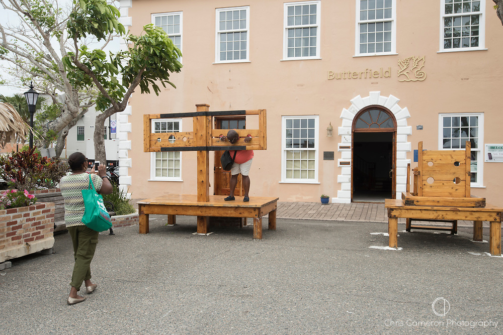 Tourists try out the stocks in Kings square at St Georges, Bermuda. 26/5/2017