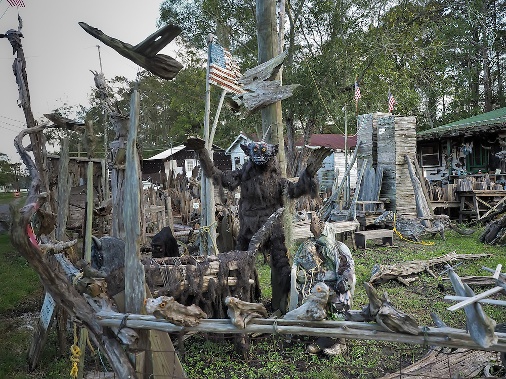 Scultures by self-taught artist, Adam Morales in front of Adam's Cypress Swamp Driftwood Family Museum in Pierre Part, Louisiana.