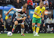 Picture by Chris Donnelly/Focus Images Ltd. 07500 903009 .17/9/11.Ivan Klasnic of Bolton and David Fox of Norwich during the Barclays Premier League match at Reebok stadium, Bolton.
