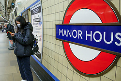 © Licensed to London News Pictures. 11/03/2020. London, UK. A commuter with a surgical face mask at Manor House station amid an increased number of cases of Coronavirus (COVID-19) in the UK. Chancellor RISHI SUNAK has unveiled a £30bn package to help the economy get through the coronavirus outbreak in the UK. Photo credit: Dinendra Haria/LNP