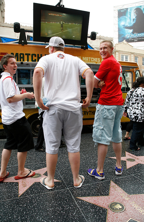 English soccer fans (L-R) Adam Fox, 23, of Sheffield, England, Neil Moore, 23, of Rotherham, England, and Wayne Loukes, 22, also of Sheffield, England watch England and the United States compete in the World Cup live on the the ESPN Match Truck in Hollywood California, USA, 12 June 2010.