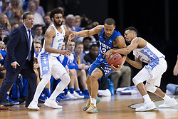 Kentucky guard Isaiah Briscoe steals the ball from North Carolina guard Joel Berry II in the first half. <br /> <br /> The University of Kentucky hosted the University of North Carolina in a 2017 NCAA D1 Men's South Regional Championship, Sunday, March 26, 2017 at FedExForum in Memphis.