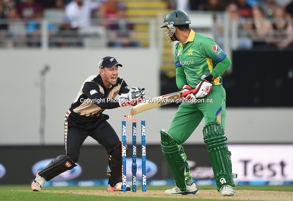 Sohaib Maqsood is caught behind by Luke Ronchi as Ronchi takes the bails off at the Twenty20 match between New Zealand Black Caps and Pakistan at Eden Park in Auckland, New Zealand. Friday 15 January 2016. Copyright photo: Andrew Cornaga / www.photosport.nz