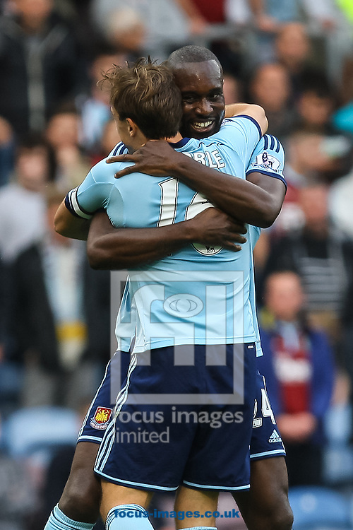 Carlton Cole of West Ham United celebrates with teammate Mark Noble of West Ham United after scoring his side's third goal during the Barclays Premier League match at Turf Moor, Burnley<br /> Picture by Daniel Chesterton/Focus Images Ltd +44 7966 018899<br /> 18/10/2014