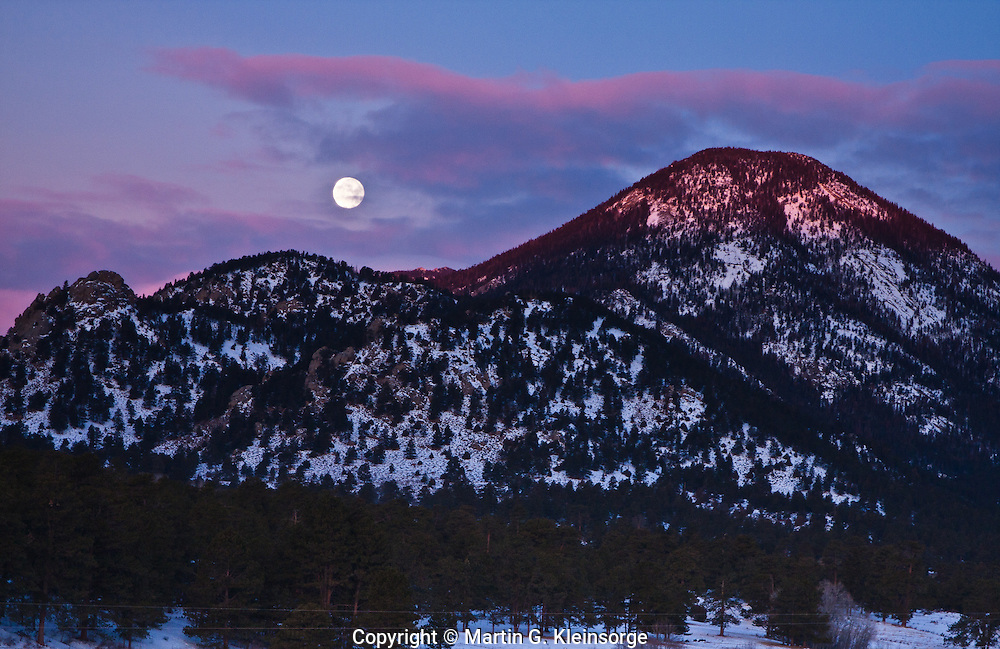 Sunrise and moon set over Castle Mountain.  Rocky Mountain National Park, Colorado.