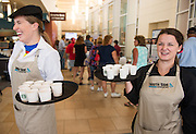 South Side Espresso Bar baristas offer sample refreshments to waiting students and parents in line for lunch in the new Nelson Dining Court. July 23, 2013. Photo by Elizabeth Held