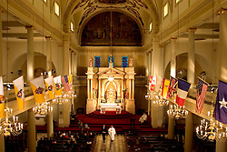 16 December, 2005. St Louis Cathedral, New Orleans, Louisiana. <br /> The Cathedral plays host to the memorial service for Sgt Paul Accardo, a New Orleans Police Information officer who died after Hurricane Katrina. Service led by Monsignor Kern.<br /> Photo; ©Charlie Varley/varleypix.com