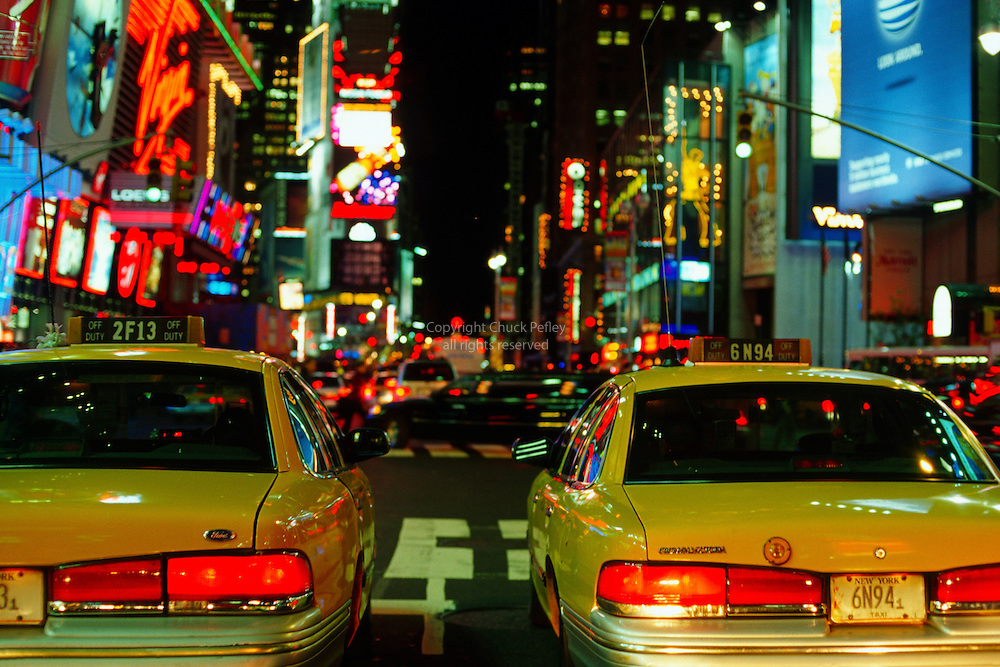 Taxi cabs on Broadway in Times Square at night, Manhattan, New York, New York