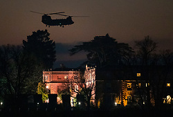© Licensed to London News Pictures. 04/12/2019. Watford, UK. A US Army Chinook helicopter flies low over The Grove Hotel as US President Donald Trump leaves the NATOSummit.  World leaders have finished attending a series of events over the two day NATO summit which marked the 70th anniversary of the alliance of nations. Photo credit: Peter Macdiarmid/LNP