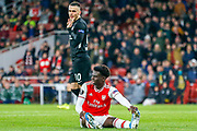 Eintracht Frankfurt midfielder Filip Kostic (10) appears to foul Arsenal midfielder Bukayo Saka (77), no penalty given, during the Europa League match between Arsenal and Eintracht Frankfurt at the Emirates Stadium, London, England on 28 November 2019.