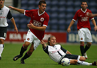 Photo: Paul Thomas.<br /> Preston North End v Manchester United. Pre Season Friendly. 29/07/2006.<br /> <br /> Darren Gibson of Man Utd gets away from Paul McKenna (R).
