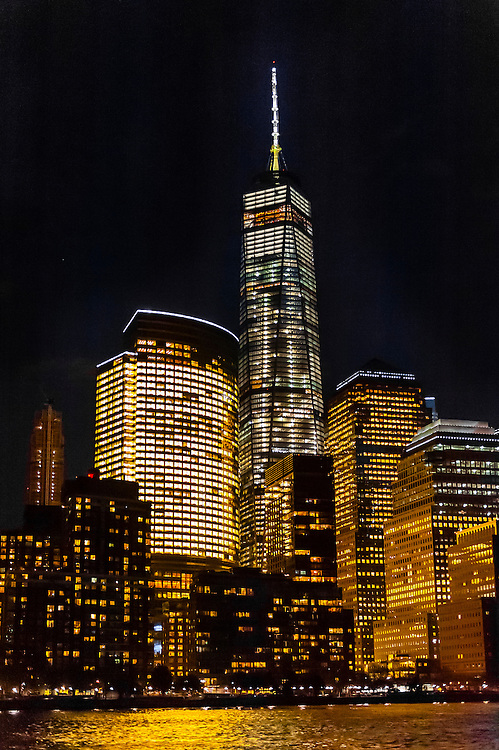 One World Trade Center  (the tallest skyscraper in the Western Hemisphere and 4th tallest in the world), towers over  the other buildings in Battery Park City, New York, New York USA.