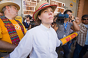 "29 JULY 2010 - PHOENIX, AZ: Rev. Susan Frederick-Gray, from the Unitarian Universalist Church in Phoenix, waits to be arrested during a blockade of the 4th Ave Jail in Phoenix Thursday.  Dozens of people were arrested during protests against SB 1070 across central Phoenix Thursday. US Judge Susan Bolton's ruling Wednesday stopped four of SB 1070's more than a dozen provisions from going into effect. She wrote, ""The court also finds that the United States is likely to suffer irreparable harm if the court does not preliminarily enjoin enforcement of these sections,"" she states in the ruling. ""The balance of equities tips in the United States' favor considering the public interest.""  PHOTO BY JACK KURTZ"