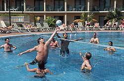 Tourists at hotel at Jibacoa; Cuba; playing game of water polo in swimming pool,