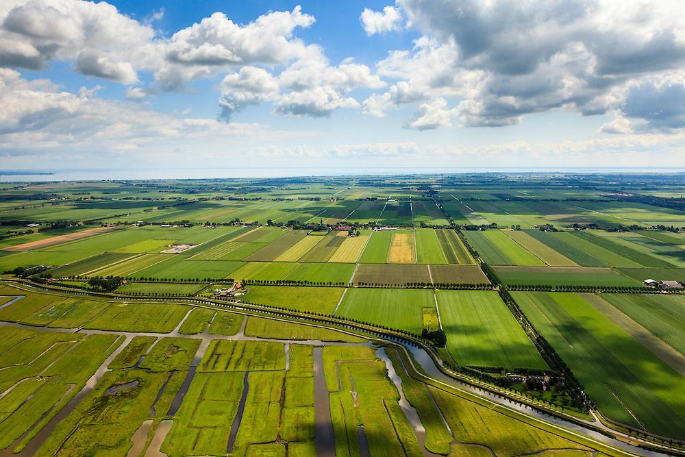 Nederland, Noord-Holland, Gemeente Schermer, 14-06-2012; Grootschermer met in de voorgrond de  Eilandspolder. Kenmerkend voor polder is de onregelmatige verkaveling en deze staat in contrast met de beroemde geometrische verkaveling van de Beemster in de achtergrond. Foto richting oostelijke richting, aan de horizon het IJsselmeer..De Beemster, een 17e eeuwse droogmakerij, is werelderfgoed (Unesco werelderfgoedlijst), de Eilandspolder is een vaarland of vaarpolder (landerijen niet bereikbaar via de weg). Natura 2000 laagveen natuurgebied. .The polder Schermer in the foreground has an irregular land division in contrast to the famous geometrical well-ordered polder Beemster, 17th century  reclaimed landscape, Unesco world heritage..luchtfoto (toeslag), aerial photo (additional fee required);.copyright foto/photo Siebe Swart