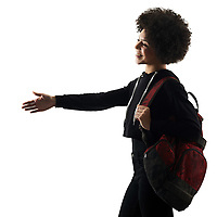 one mixed race african young teenager girl woman handshaking in studio shadow silhouette isolated on white background