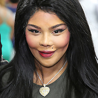 LAS VEGAS, NV - APRIL 14: Rapper Lil' Kim attends a workout by WBC/WBA welterweight champion Floyd Mayweather Jr. at the Mayweather Boxing Club on April 14, 2015 in Las Vegas, Nevada. Mayweather will face WBO welterweight champion Manny Pacquiao in a unification bout on May 2, 2015 in Las Vegas.  (Photo by Alex Menendez/Getty Images) *** Local Caption *** Lil' Kim