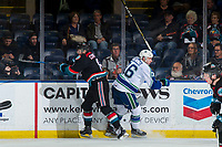 KELOWNA, CANADA - OCTOBER 23: Jack Cowell #8 of the Kelowna Rockets checks Andrew Fyten #26 of the Swift Current Broncos during second period on October 23, 2018 at Prospera Place in Kelowna, British Columbia, Canada.  (Photo by Marissa Baecker/Shoot the Breeze)