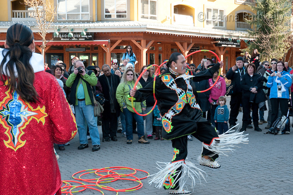 A first nations hoop dancer from the troupe Wonderbolt dances the Hoop Dance during the 2010 Olympic Winter Games in Whistler, BC Canada.