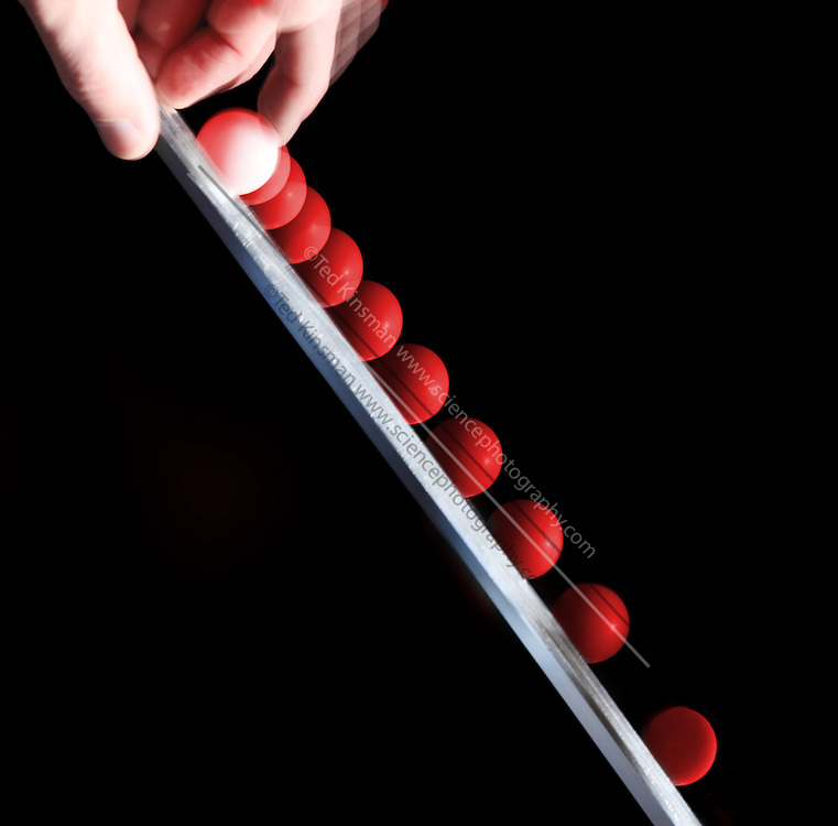 .This is a demonstration of a ball rolling down an incline. The analysis of this demo requires the use of the  kinetic energy, potential energy, rolling energy, and friction.   The  ball is 2.5 cm in diameter. The flash illuminates the scene at 40 hz showing images every  .025 seconds of time. .
