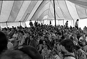 300 Girl Guides At Larch Hill.  (R84)..1988..25.07.1988..07.25.1988..25th July 1988..As part of the Diamond Jubilee celebrations the girl guide movement organised a friendship camp for 300 girls.The friendship camp was set up in the grounds of Larch Hill, Tibradden,Co Dublin. The camp will run from 23rd July to 30th July...Image shows the guides and their mentors assembling for the mass and official opening of the friendship camp.