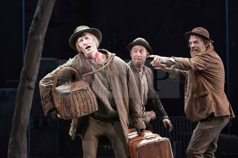 """© Licensed to London News Pictures. 05/06/2015. London, UK. L-R: Luke Mullins as Lucky, Richard Rockburgh as Estragon and Hugo Weaving as Vladimir. Actors Richard Roxburgh and Hugo Weaving star in Samuel Beckett's """"Waiting for Godot"""" at the Barbican Theatre. Part of the International Beckett Season, this Sydney Theatre Company play is directed by Andrew Upton. With Luke Mullins as Luke, Philip Quast as Pozzo, Richard Roxburgh as Estragon and Hugo Weaving as Vladimir. Performances from 4 to 13 June 2015 at the Barbican Theatre. Photo credit : Bettina Strenske/LNP"""