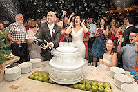 Julian and Noleen celebrate with Champagne before cutting their cake at their wedding in Rome, Italy. Photo by documentary wedding photographer James Horan - Solas Wedding and Portrait Photography