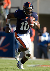 Virginia quarterback Jameel Sewell (10) rushes up field...The Virginia Cavaliers defeated the Connecticut Huskies 17-16 at Scott Stadium in Charlottesville, VA on October 13, 2007
