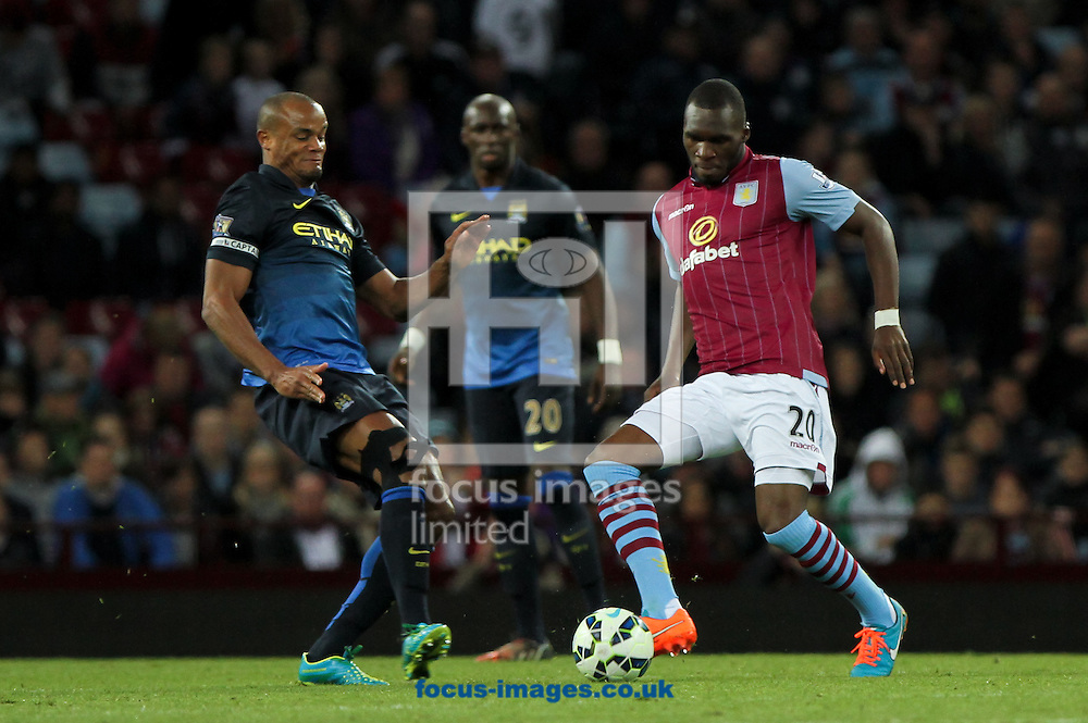 Christian Benteke (right) of Aston Villa and Vincent Kompany (left) of Manchester City battle for the ball during the Barclays Premier League match at Villa Park, Birmingham<br /> Picture by Tom Smith/Focus Images Ltd 07545141164<br /> 04/10/2014
