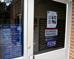 The window of the Post Office in Canadensis displays a wanted poster for Eric Matthew Frein. Police continue to search for fugitive Eric Matthew Frein on Oct. 10, 2014, near Canadensis, PA. Frein is accused of shooting two Pennsylvania State Troopers fatally wounding one 28 days ago. (Chris Post | lehighvalleylive.com)