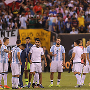 EAST RUTHERFORD, NEW JERSEY - JUNE 26:  Argentinian players after their penalty shoot out loss during the Argentina Vs Chile Final match of the Copa America Centenario USA 2016 Tournament at MetLife Stadium on June 26, 2016 in East Rutherford, New Jersey. (Photo by Tim Clayton/Corbis via Getty Images)