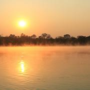 Sunrise at Kavango river whit mist on the water surface, Caprivi region. Namibia