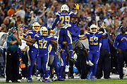 San Diego Chargers inside linebacker Denzel Perryman (52) and San Diego Chargers inside linebacker Joshua Perry (53) begin to celebrate on the sideline as San Diego Chargers cornerback Craig Mager (29) jumps in the air and celebrates after recovering a fumble on a late fourth quarter pass play to Denver Broncos wide receiver Demaryius Thomas (88) during the 2016 NFL week 6 regular season football game against the Denver Broncos on Thursday, Oct. 13, 2016 in San Diego. The Chargers won the game 21-13. (©Paul Anthony Spinelli)
