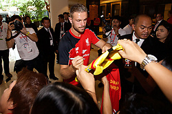 BANGKOK, THAILAND - Monday, July 13, 2015: Liverpool's captain Jordan Henderson signs autographs for supporters at the Plaza Athenee team hotel in Bangkok on day one of the club's preseason tour. (Pic by David Rawcliffe/Propaganda)