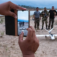 Peruvian National Police Special Forces members from the Mega 12 base take a photo with CINCIA's drone. Following Peru's February 2019 militarized crackdown on illegal and unofficial alluvial gold mining in the La Pampa region of Madre de Dios, Wake Forest University's Puerto Maldonado-based Centro de Innovación Científica Amazonia (CINCIA), a leading research institution for the development of technological innovation for biological conservation and environmental restoration in the Peruvian Amazon, is applying years of scientific research and technical experience related to understanding mercury contamination and managing Amazonian ecosystems. What they learn will help guide urgent remediation, restoration, and reforestation efforts that can also serve as models for how we address the tropic's most dramatically devastated landscapes around the world. La Pampa, Madre de Dios, Peru.
